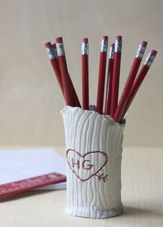 Make your own too-cute tree trunk pencil holder.