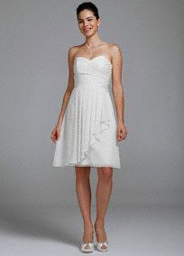 A short and charming look you will love on you special day!  Strapless bodice with pleated bust features ultra-feminine sweetheart neckline.  Layers of soft crinkle chiffon cascading rufflesgives this dress a whimsical feel.  Fully lined. Back zip.Imported polyester. Dry clean.  To protect your dress, try our Non Woven Garment Bag.