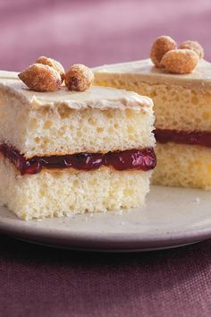 Jelly sandwiched between cake layers and topped with sweetened peanut butter frosting and roasted peanuts!