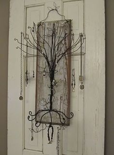 jewelry wire and wood wall hanger.  This would be gorgeous on the back of a display