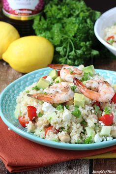 ... Grilled shrimp is layered over quinoa, fresh veggies and olive oil red