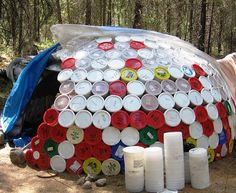 "**Chicken coop idea?** It's called the ""Ice Cream Igloo"" because it's made almost entirely out of old ice cream buckets. You can still read many of the flavors printed on the lids."