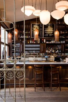 The Local Taphouse designed by Gardener & Marks Interior Decoration. Photo by Tim James Photography. bar lighting, lights, wine bars, shop, light fixtures, interiors, drink, cafe bar, bar designs