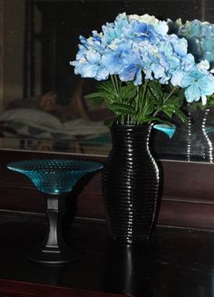 Left: a spray painted candlestick ($1) and glass bowl ($1) The vase ($1) on the Right: vase with interior spray painted. The flowers (Garden Ridge) were 75% off, so I got two bunches for 68 cents! Everything else was from Dollar Tree!