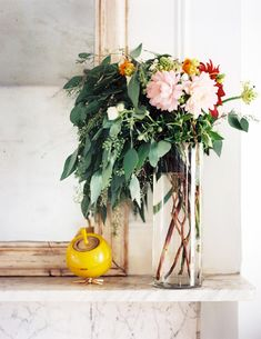 mirror,glass vase with flowers