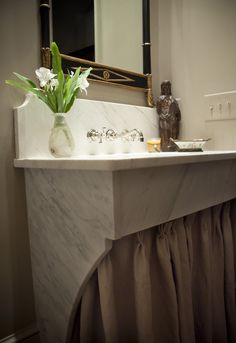 Lovely marble skirted vanity, guest baths