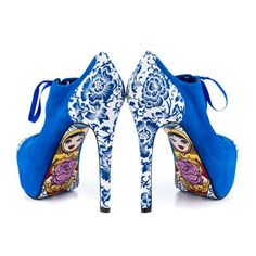 This fun style features a bright blue fabric with beautiful floral trim. Underneath, a nesting doll is pictured on the sole with whimsical detailing. #InkedShop #NestingDoll #heels #blue #floral #heels #shoes #style #fashion