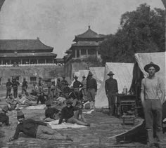 U.S. Army encampment outside the Meridian Gate (Wumen) of the Forbidden City during the  Boxer Rebellion, 1898-1900.  These men wear the older uniforms
