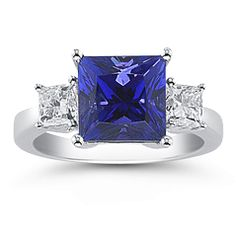 My DREAM ring! Perfect deep color tanzanite, princess cut, simple setting with side diamonds in 14K white gold. I would prefer something around 2ct, and this is 4ct, but wow.