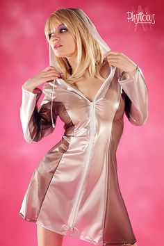 Plastic Fetish lover Jana shows her sexy curves in this silver transparent plastic raincoat. See more sexy sets of Model Jana in beautiful transparent vinyl in our members section http://www.plastilicious.com