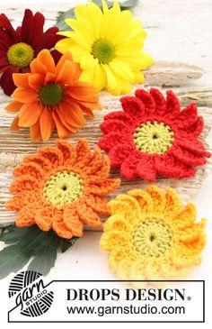 """Crochet DROPS Marguerite flowers in """"Safran"""". ~ DROPS Design. Free pattern."""
