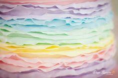 I love this rainbow ruffle cake at a Pastel Rainbow Hot Air Balloon Party via Kara's Party Ideas KarasPartyIdeas.com #RainbowParty #HotAirBalloon #PartyIdeas #PartySupplies #RuffleCake