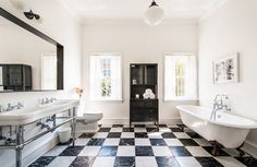Black and white bathroom with checkered tiles.