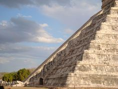 """Spring equinox 2009 at Chichen Itza, Mexico. A golden snake of light appears to slither down the steps of the pyramid dedicated to Kukulkan, the feathered serpent god. (credit: ATSZ56) Mona Evans, """"Vernal Equinox"""" http://www.bellaonline.com/articles/art182925.asp"""