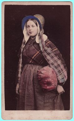 A Belgian lace-maker, identified by her costume and the lace-pillow under her arm, which would have been held on her lap while working on lace. Photographer unknown, via Paul Frecker Nineteenth Century Photography.