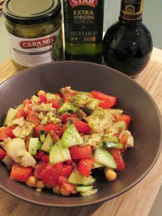 Artichoke, Chickpea and Cucumber Salad: A salad with hearty chickpeas, Cara Mia Marinated Artichokes,  fresh cucumber, and tomatoes with a simple dressing.