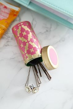 Turn an old prescription bottle into a hair tie holder for your purse