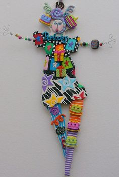 They are made from polymer clay, wire & beads and possibly any other 'fun' things I may run across!