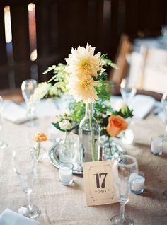 floral centerpieces, photo by Danielle Poff http://ruffledblog.com/dana-powers-house-wedding #centerpiece #weddingideas