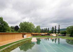 Herzog & de Meuron creates natural swimming pool in Switzerland.