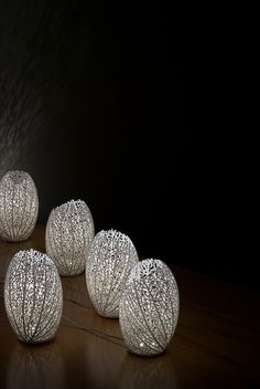 Hyphae table lamps, by Nervous System.  These lamps are an infinite series of one-of-a-kind lamps inspired by leaf venation. The lamps are grown in the computer and then 3D-printed in nylon.  The possibilities of 3D printing are mind-boggling!    #art