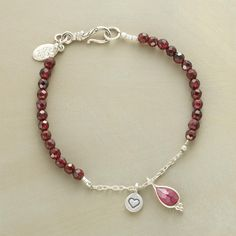 """PURE INSPIRATION BRACELET--The warmth of faceted garnets joins cool sterling silver links and a silver-framed pink tourmaline drop. Sterling silver heart charm and clasp. Handcrafted in USA. Exclusive. 7-1/4""""L."""