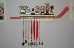 This is Sage's trophy shelf with her first hockey stick. Super easy to make