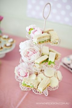 finger sandwiches nestled in a cupcake tower