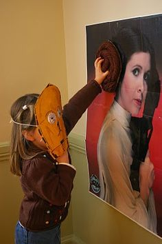 During Quiet Time: Star Wars Birthday Party pin the bun on Princess Leia