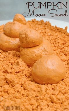 Homemade Pumpkin Moon Sand Recipe- this moon sand has such a FUN & unique texture. It is sand-like but soft and squishy. It can be molded and holds it's shape really well but also has a bit of an ooze to it. It is really hard to describe and so fun you really must try it for yourself (Kids LOVE this stuff!)