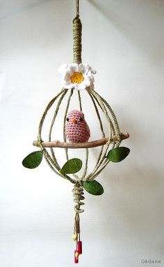 a whisk turned into a birdcage :)