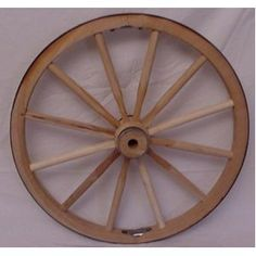 "Steam Bent Hickory Wood Western Wagon Wheel for Home and Garden Decor 30"" X 1"". Handcrafted By Old Order Amish Wheel Makers. These Country Collectible Wheels Can Be Used on Small Carts or Wagons with a Weight Bearing Capacity of 500 Lbs. They Are Perfect As Home and Garden Country Landscape Decor. Just the Right Size for Indoor or Outdoor Use. Authentic Wagon Wheel That Makes a Unique and Rustic Statement. Makes a Stunning Wagon Wheel Chandelier."