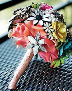 Brooch Bouquet: Find 50 to 60 vintage brooches on eBay, at local antique stores and in your grandma's jewelry box. Then have them crafted into a unique bouquet that you can keep as an heirloom. Photo by Louisa Lopez/The Loft Photography