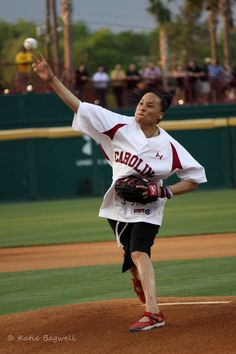 My favorite photo of USC Women's Basketball Coach, Dawn Staley, throwing out the first pitch at the Carolina vs. Wofford game.