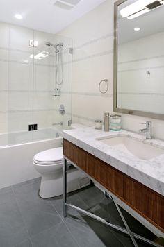 Contemporary bathroom with custom vanity by Johnson & Associates Interior Design