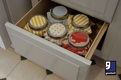 Looking to organize your kitchen? Try using jars from your local #Goodwill and some thrifted fabric for a whole new way to organize kitchen drawers with advice from Goodwill blogger @Julia Berry