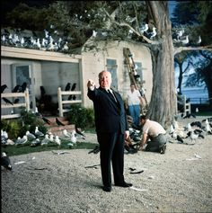 Badass photo of Alfred Hitchcock on the set of The Birds