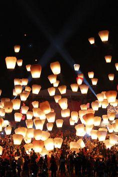 See hundreds of sky lanterns floating away...