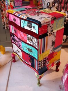 Mod Podge fabric onto dresser - and I got one waiting for re-styling too!! All I need now is 48 hour day :)