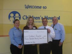 "Publix visited Children's Hospital to present a check from their ""Produce for Kids"" campaign.  Thanks to Publix for being a wonderful partner! kid"