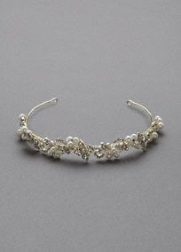 This gorgeous headband offers a traditional look for the classic bride!  Headband features embellished pave crystal flowers and pearl clusters.  Available in Gold and Silver.  Imported.