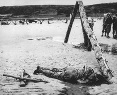 An anonymous American soldier, who died in combat during the Allied invasion, lies on the beach of the Normandy coast, in the early days of ...