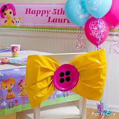 """Cute DIY alert! This sew-cute chair decoration is made of a plastic table cover and paper plates for """"buttons"""". Get details from our Lalaloopsy party ideas guide!"""