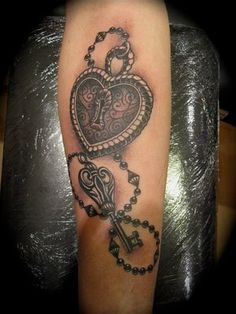 black love heart with door lock and key on the chain tattoo - Heart tattoos