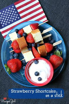 Strawberry Shortcake on a Stick - RecipeGirl.com - great, grab and go handheld dessert for a 4th of July party.