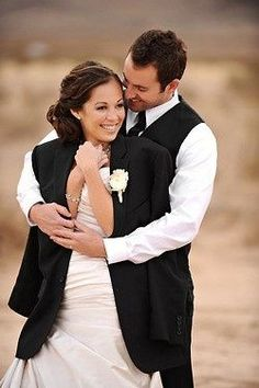 Take a picture in your grooms jacket... One of the best ideas for wedding pictures! -- but look at each other:)