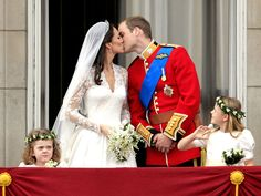 Kate Middleton and Prince William share a wedding kiss