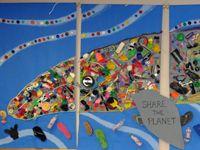 Whale mosaic made of beach trash.