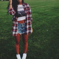 Pair our vintage flannel with high waisted shorts!
