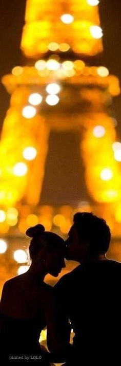 Love under the lights of the Eiffel Tower.